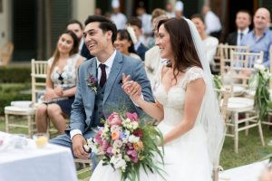 classy wedding in Florence - couple exchange of vows in a garden
