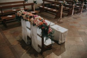 whimsical wedding in Tuscany - church pew decor