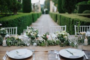 Swedish wedding in tuscany - green and blush flowers for the wedding table