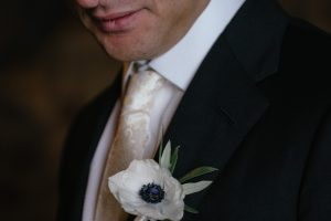 sophisticated wedding in Tuscany - anemones groom buttonhole