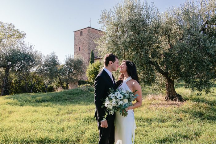 sophisticated wedding in Tuscany - couple reveal in olive groves