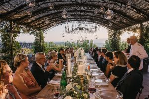 sophisticated wedding in Tuscany - family style outside reception