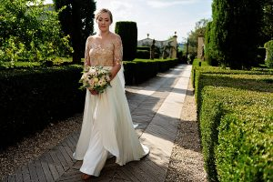 Garden wedding in Florence - bride walking down the aisle