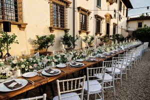 Garden wedding in Florence - long wedding table full of flowers