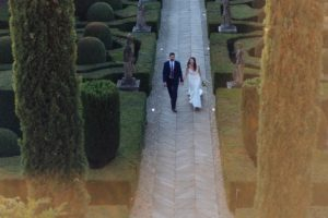 couple walking to the wedding reception - rustic minimalist wedding in Florence