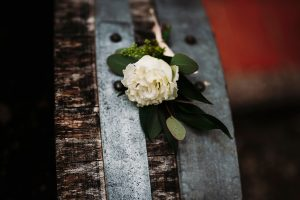 white and green buttonhole for the groom - dream wedding in San Gimignano