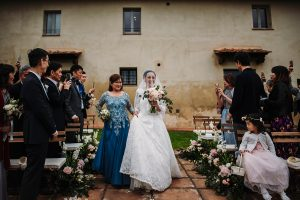 bride walking down the aisle with her mom dream wedding in San Gimignano