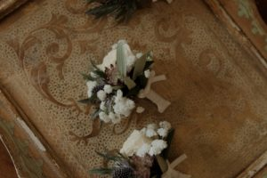 Wedding with a bump in Tuscany Scottish thistle buttonholes