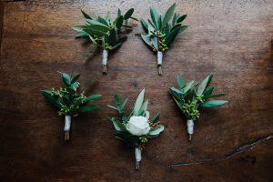 Spring wedding - green and white men buttonholes