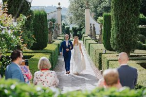 Spring wedding - entrance of the bride and groom in the italian garden