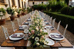 Garden wedding Florence - dinner wooden table in a villa