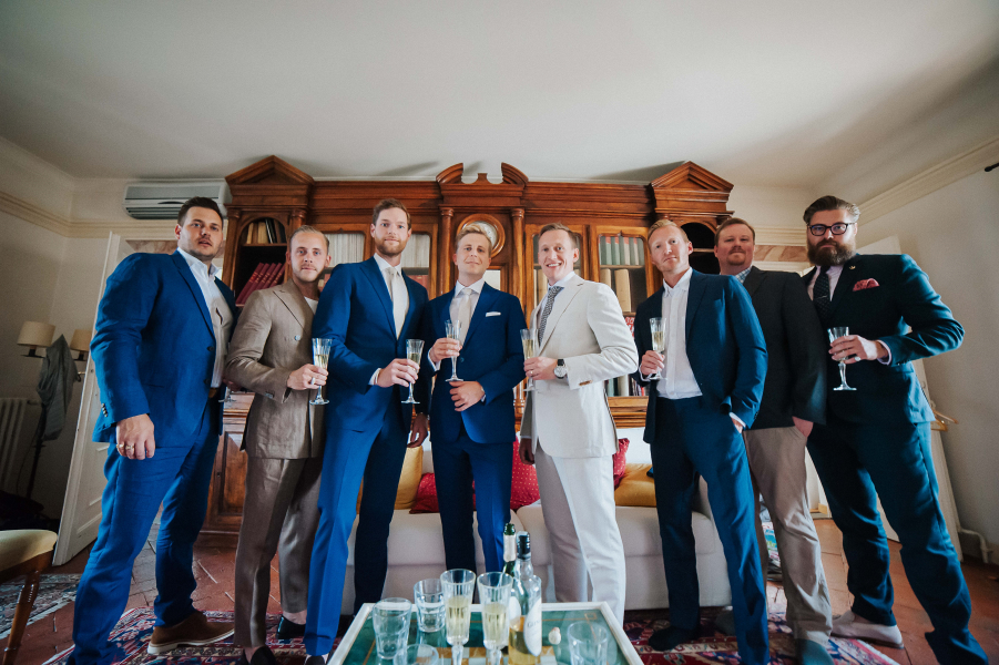 How long plan destination wedding - the boys with prosecco before the ceremony