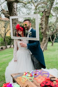 wedding lawn games - photo booth frames with props and happy couple