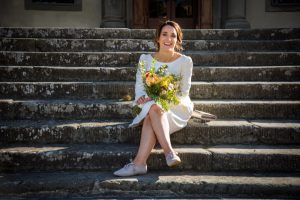 marriage abroad - bride before eloping with a fall bouquet
