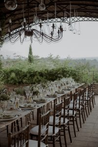 wedding baby bump - long wooden table with green and white flowers