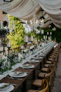 wed in florence - romantic Jewish wedding - tuscan barocco flower design with iron chandelabras and iron vases