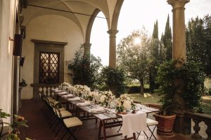 intimate catholic wedding Tuscany - reception table under a porch of the villa