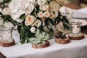 intimate catholic wedding Tuscany - succulents and wooden holders