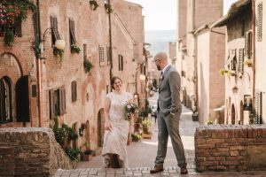 glamorous elopement Italy - bride and groom wlaking to the ceremony together
