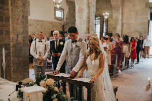 rustic catholic wedding Tuscany - bride and groom at the altar during the wedding mass