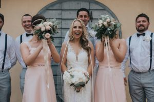 rustic catholic wedding Tuscany - bridal party with bouquets made with greenery and white and pale pink flowers