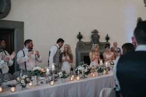rustic catholic wedding Tuscany - weddng top table decoration with silver vases and candles