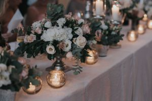 rustic catholic wedding Tuscany - antiqued silver for candels and centerpieces, vases with white and pale pink flowers