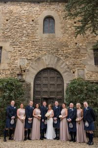 Scottish wedding - Wed in Florence - bridal party, groomsmen and bride and groom in front of the castle's door