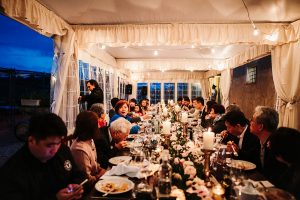 chinese wedding tuscany - wed in florence - bride, groom and guests eating italian food during dinner