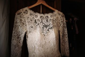 chinese wedding tuscany - wed in florence - bride gown made with lace and with long sleeves