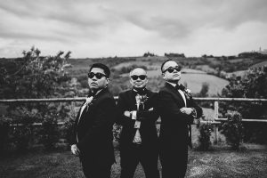 chinese wedding tuscany - wed in florence - groomsmen making funny poses