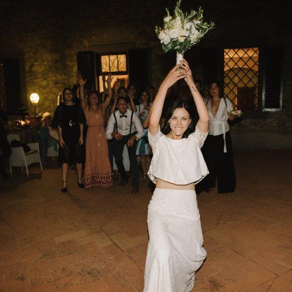 organic wedding - bride tossing the bouquet