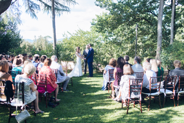 simple wedding - bride and groom exchaning vows during the ceremony