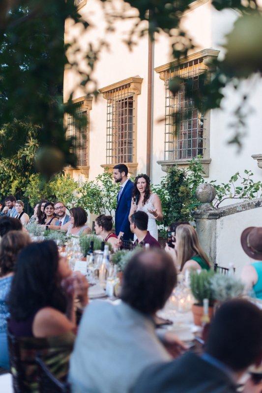 simple wedding - bride and groom speech during dinner