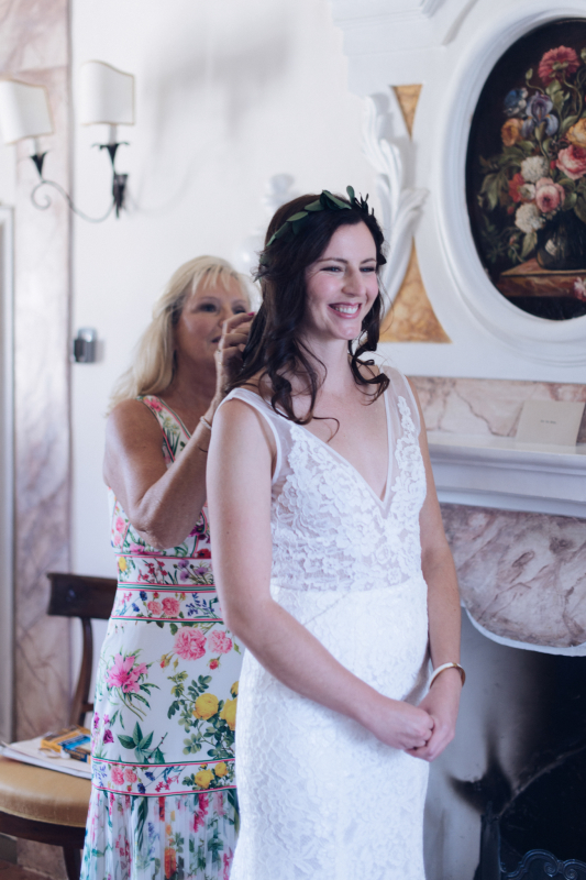 simple wedding - bride getting ready in the bridal suite with her mother